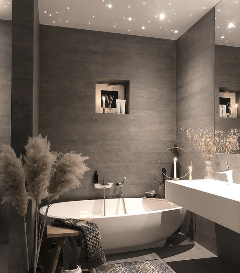 Stunning greyscale bathroom with a tub and modern basic all keeping to a Dark Colour Scheme